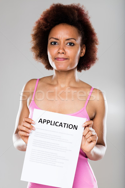 suspicious woman with an application form  Stock photo © Giulio_Fornasar
