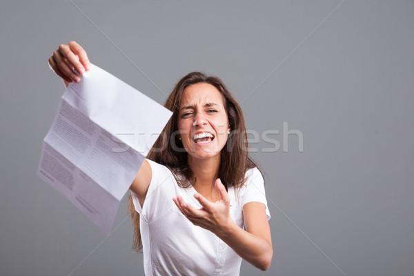 Mérges nő rossz hírek külső csinos tartalom Stock fotó © Giulio_Fornasar