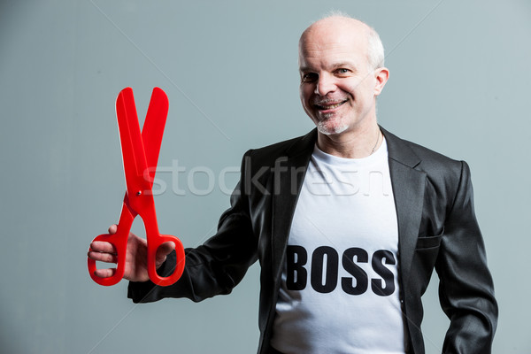 Smiling senior businessman wearing a Boss t-shirt Stock photo © Giulio_Fornasar