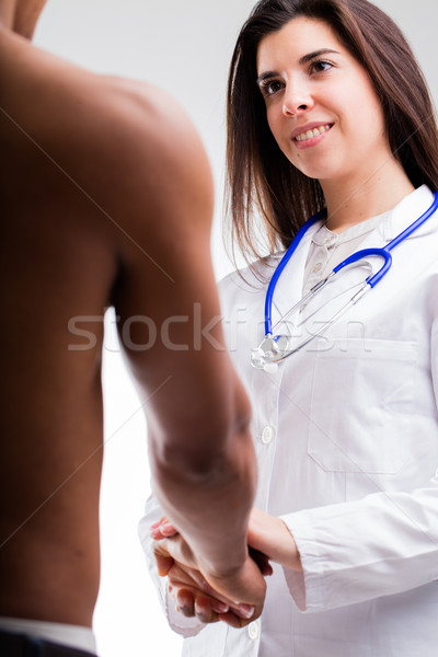 doctor attending to an afro-american patient Stock photo © Giulio_Fornasar