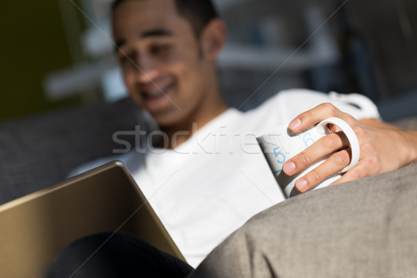 young man having fun with movies and drink Stock photo © Giulio_Fornasar
