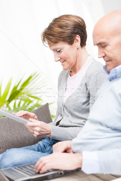 Tech savvy couple with a laptop and tablet Stock photo © Giulio_Fornasar