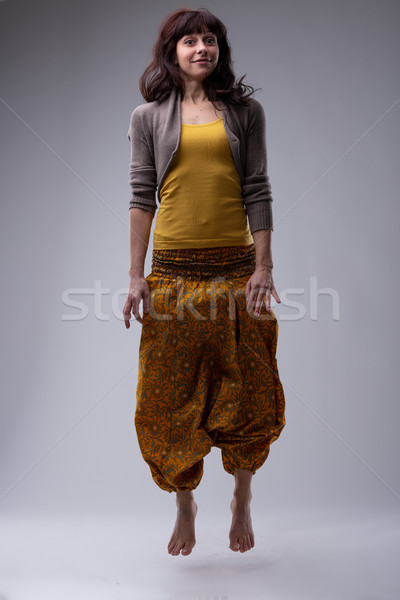 Trendy barefoot woman jumping in the air Stock photo © Giulio_Fornasar