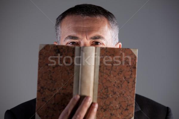 mature man behind an ancient book Stock photo © Giulio_Fornasar
