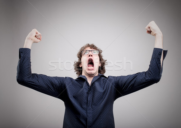 man winning and exulting with a strong expression Stock photo © Giulio_Fornasar