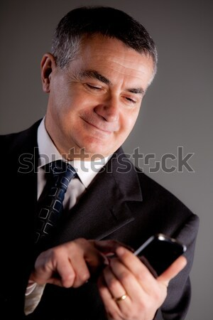 Stock photo: Senoir man using successfully a tablet