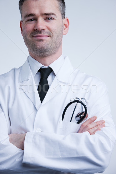 self confident available doctor in white coat Stock photo © Giulio_Fornasar