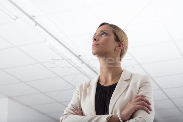 Stijlvol zakenvrouw denken probleem permanente gevouwen Stockfoto © Giulio_Fornasar