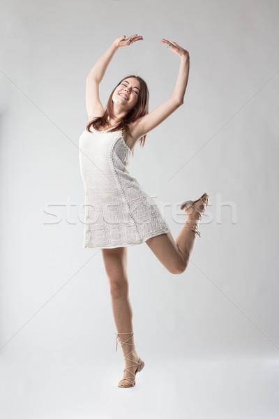 very happy woman dancing happily Stock photo © Giulio_Fornasar
