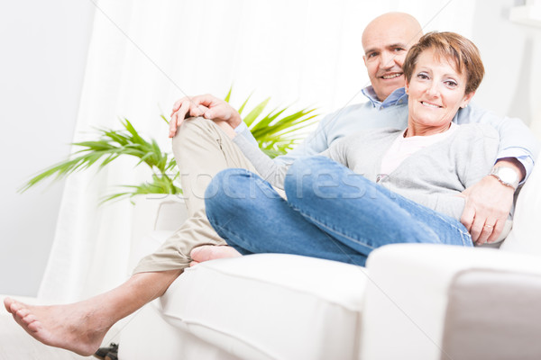 Barefoot middle-aged couple relaxing at home Stock photo © Giulio_Fornasar