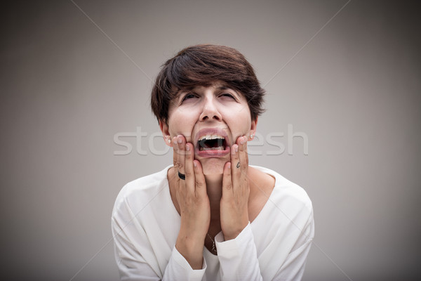 Stock photo: woman just wanting to cry because of her anguish