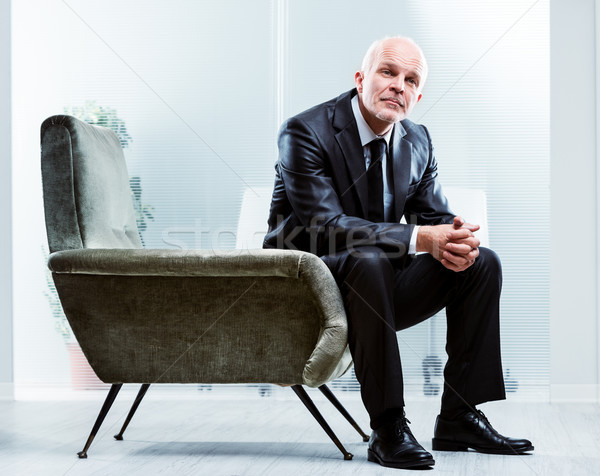 Pensive senior businessman sitting in an armchair Stock photo © Giulio_Fornasar