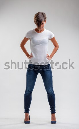 Muscular fit woman in denim jeans Stock photo © Giulio_Fornasar
