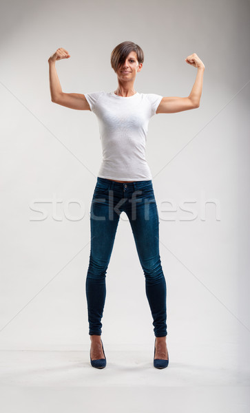 Full length of a fit beautiful woman posing strong Stock photo © Giulio_Fornasar