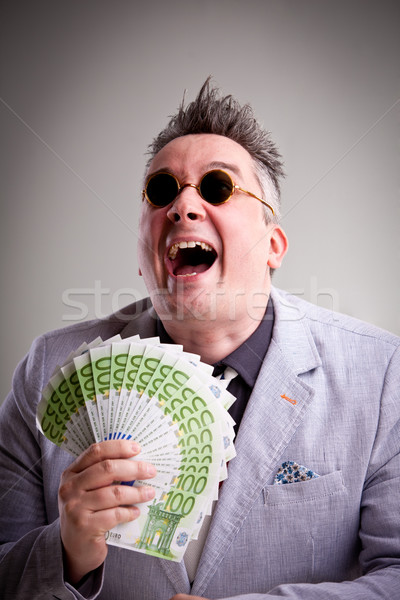 bossy crook sneering with stolen money Stock photo © Giulio_Fornasar
