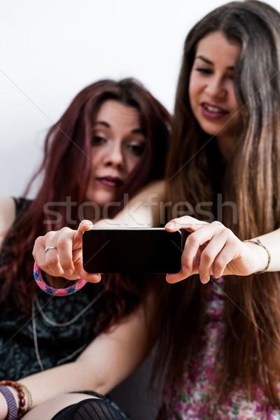 женщины смотрят мобильного телефона что-то Сток-фото © Giulio_Fornasar