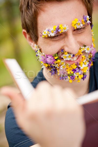 smiling hippy hipster reading face flower-covered Stock photo © Giulio_Fornasar