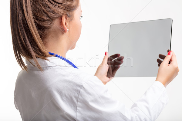 Female doctor holding a transparent tablet Stock photo © Giulio_Fornasar