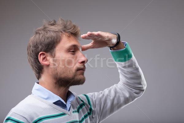 Szőke férfi távolság kéz kiemelt homlok Stock fotó © Giulio_Fornasar