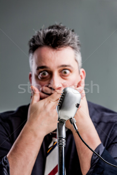 man scared to speak on the microphone Stock photo © Giulio_Fornasar