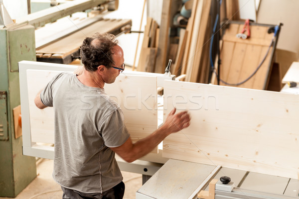 woodworker assembling a piece of furniture Stock photo © Giulio_Fornasar