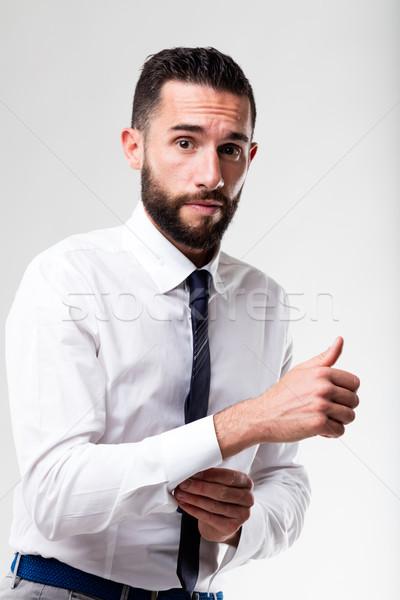 elegant man hesitant while dressing up Stock photo © Giulio_Fornasar