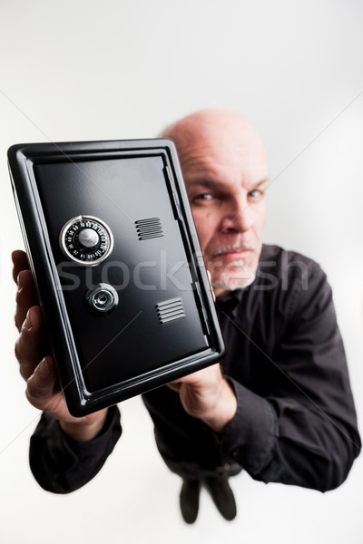 safe held by a serious businessman Stock photo © Giulio_Fornasar