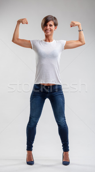 Muscular fit woman flexing her muscles Stock photo © Giulio_Fornasar