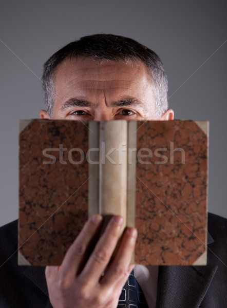 mature man behind an ancient book Stock photo © Giulio_Fornasar