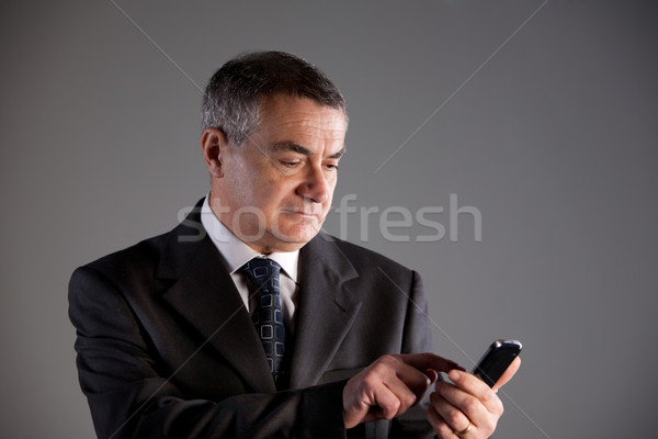 old man using a mobile phone Stock photo © Giulio_Fornasar