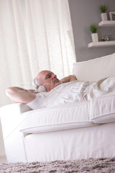 Homme détente canapé homme mûr blanche salon Photo stock © Giulio_Fornasar