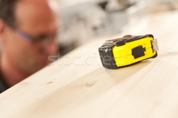 measuring tape in focus in carpenter workshop Stock photo © Giulio_Fornasar
