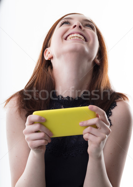 happy woman with a yellow mobile phone Stock photo © Giulio_Fornasar