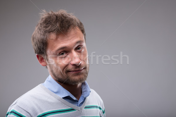 Charismatic man with a rueful smile Stock photo © Giulio_Fornasar