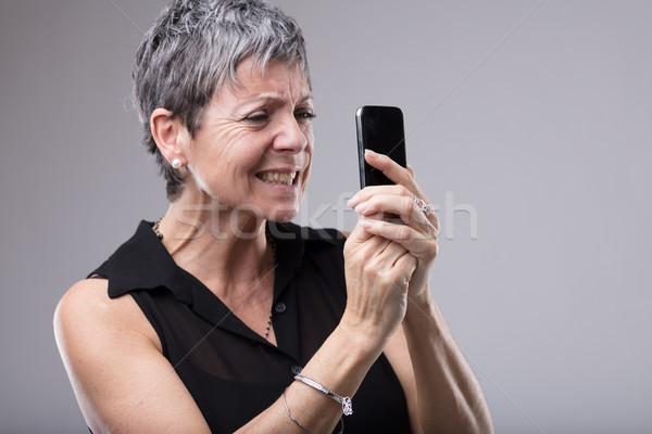 женщину зубов старший мобильного телефона рук Сток-фото © Giulio_Fornasar