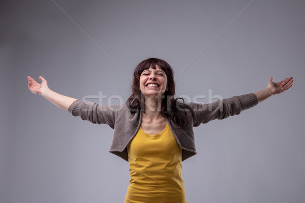 Happy elated woman celebrating Stock photo © Giulio_Fornasar