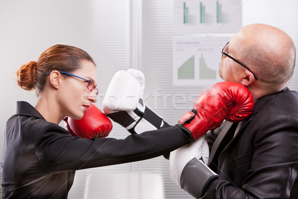 woman punching a man on the face in a box match Stock photo © Giulio_Fornasar