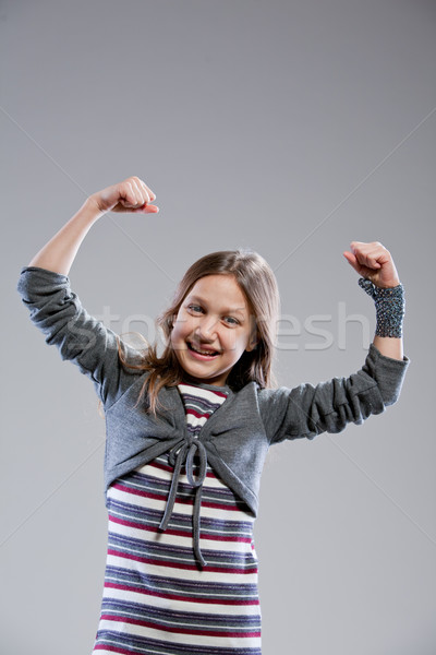 I'm the strongest girl in the world Stock photo © Giulio_Fornasar
