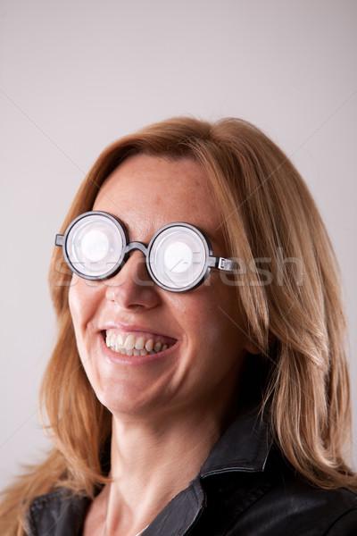őrült őrült nő szemüveg portré hatalmas Stock fotó © Giulio_Fornasar