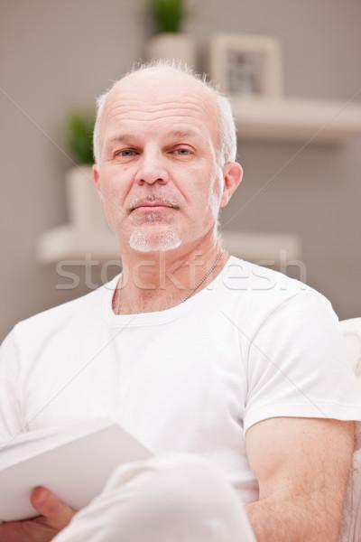 Ciddi portre yorgun adam oturma odası okumak Stok fotoğraf © Giulio_Fornasar