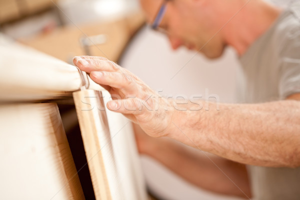 carpenter's hand placing a board Stock photo © Giulio_Fornasar