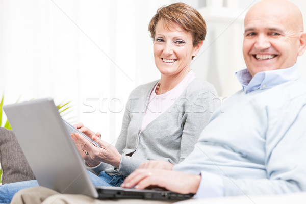 Genuine couple with lovely beaming smiles Stock photo © Giulio_Fornasar