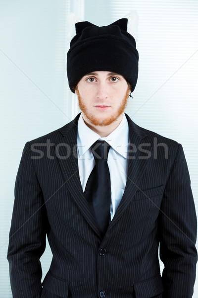 Strange businessman wearing a knitted cap and suit Stock photo © Giulio_Fornasar