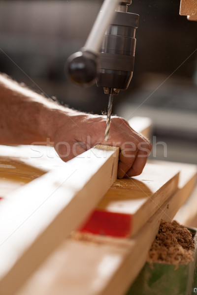 woodworker drilling a plank with machinery Stock photo © Giulio_Fornasar