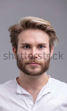 Portrait of a handsome young bearded man thinking Stock photo © Giulio_Fornasar