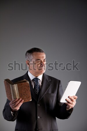 reading books or ebooks for an old man Stock photo © Giulio_Fornasar