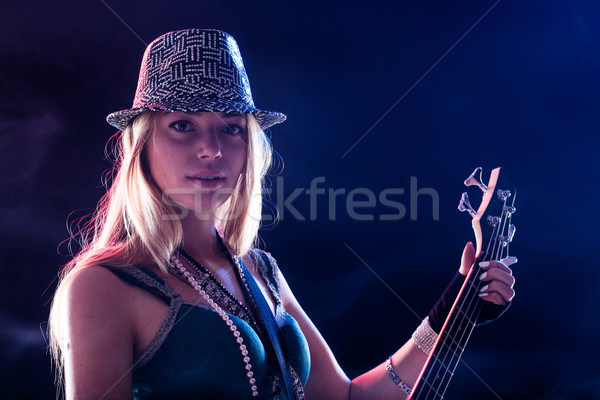 young woman performing live as guitar player Stock photo © Giulio_Fornasar