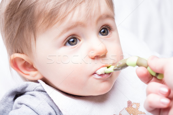 infant girl fed by her mother's hand Stock photo © Giulio_Fornasar