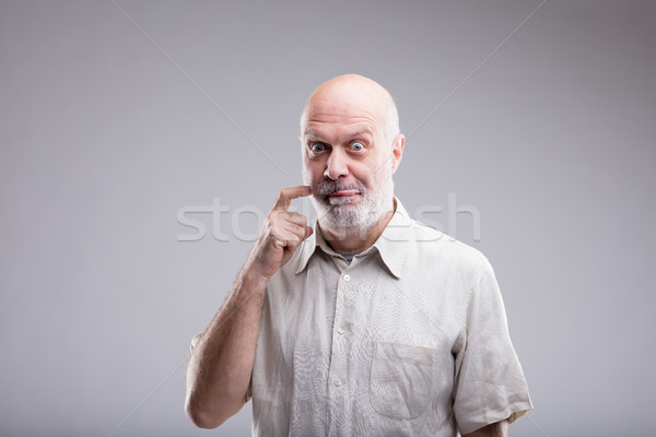 gluttonous bald old man says yummy Stock photo © Giulio_Fornasar
