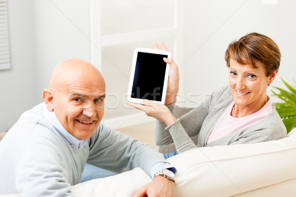 Mature couple displaying a blank tablet-pc Stock photo © Giulio_Fornasar